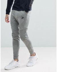Nike - Tech Fleece Tapered Fit Joggers In Green 886175-004 - Lyst