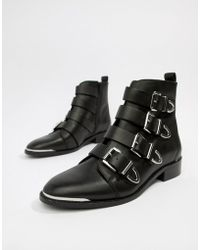 Office - Archive Four Buckle Black Leather Ankle Boots - Lyst