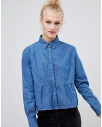 ASOS DESIGN - Denim Shirt With Ruffle Hem In Midwash Blue - Lyst