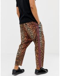 30ceadfcf4b819 ASOS - Oversized Tapered Pants In Leopard Print With Side Tape - Lyst