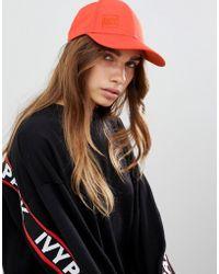 Ivy Park - Running Backless Cap In Orange - Lyst