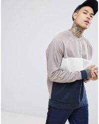 ASOS - Sweat-shirt oversize avec empiècement en imitation peau de mouton - Lyst