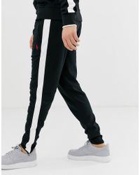 online store 1c216 4931e Slim Fit Zipped Hem Track Trousers With Side Tape In Black