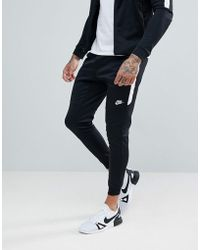 Nike - Tribute Poly joggers In Black 884898-010 - Lyst