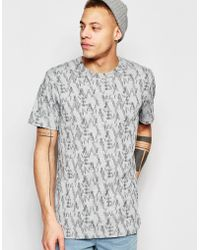 WÅVEN - T-shirt Lucas Crew Neck All Over Camo Logo Print - Lyst