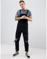 ASOS - Skinny Denim Dungarees In Black With Heavy Rips - Lyst