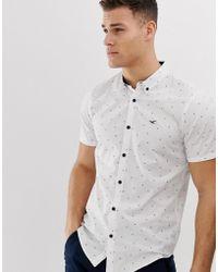 buscar gran descuento de 2019 precio bajo Camisa Oxford de corte slim y manga corta blanca con estampado geométrico  en toda la prenda y logo de icono - Blanco