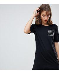 d49d1f7f10 River Island - T-shirt lunga nera con scritta
