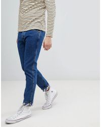 Wrangler - Tapered Jeans With Turn Up Details - Lyst