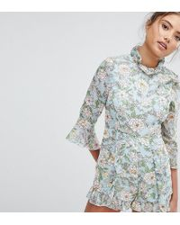 PrettyLittleThing - High Neck Floral Playsuit - Lyst