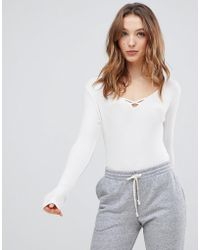 NYTT - Mia Cross Lace Up Front Bodysuit - Lyst