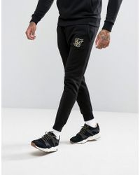 SIKSILK - Joggers In Black With Gold Logo - Lyst
