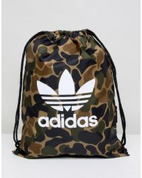 02069fbe01 Lyst - Adidas Originals Drawstring Backpack In Blue Ay7828 in Blue ...