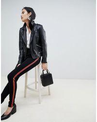 Pieces - Camille Sports Stripe leggings - Lyst