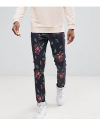 ASOS DESIGN - Asos Tall Skinny Trousers In Oversized Rose Print - Lyst