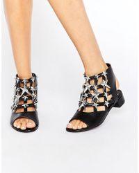 E8 - Gisele Black & Silver Star Sandals - Lyst