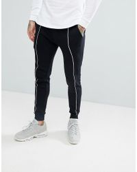 ASOS - Super Skinny Joggers In Black With White Piping - Lyst
