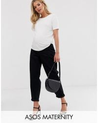 ASOS - Asos Design Maternity Tapered Boyfriend Jeans With Curved Seams In Clean Black With Concealed Bump Waistband - Lyst