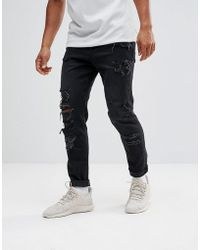 ASOS - Jeans stretti in fondo da 12,5 once nero slavato con strappi pesanti - Lyst
