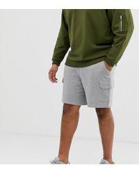 ASOS - Pantalones cortos de punto holgados gris marga con bolsillos cargo de Plus - Lyst
