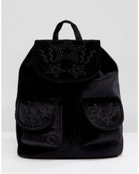 Skinnydip London - Star Embossed Pocket Velvet Backpack - Lyst