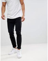 Burton Tapered Jeans In Black