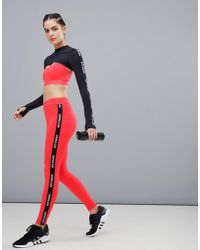 Ivy Park - Active Logo Taped Side Stripe Leggings In Red - Lyst