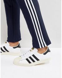 detailed look 91e18 9ddd6 Superstar 80's Trainers In White G61070