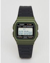 G-Shock - F-91wm-3aef Digital Silicone Watch In Black/green - Lyst