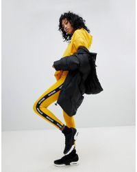 Ivy Park - Active Logo Taped Leggings In Orange - Lyst