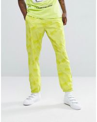 Billionaire Boys Club - Ice Cream - Track Joggers With Repeat Logo Print In Cyber Yellow - Lyst