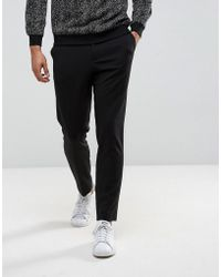 SELECTED - Tapered Cropped Jersey Trousers - Lyst