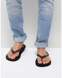 Hollister - Solid Rubber Logo Flip Flop In Black - Lyst