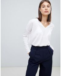 ASOS - Top With V-neck In Oversized Lightweight Rib In White - Lyst