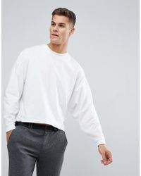 ASOS - Oversized Long Sleeve T-shirt With Extreme Batwing In Cropped Length In White - Lyst