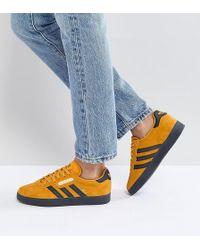 Lyst adidas originali originali gazzella formatori in giallo