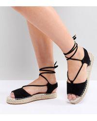 7e8bf5d39007 ASOS Asos Fizzle Jelly Tie Leg Sandals in Black - Lyst