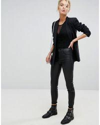Stradivarius - Coated Denim Skinny Jeans In Black - Lyst