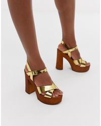 d60512d6e9a Lyst - The March Rose Gold Block Heeled Sandals in Metallic
