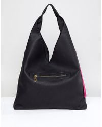 Yoki Fashion - Slouchy Shoulder Bag In Black With Tassel - Lyst