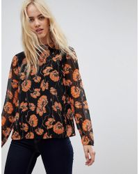 32bc6d2bbae Lyst - Stradivarius Floral Print Blouse With Circle Detail in Black