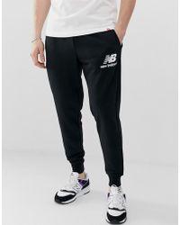 12d16fac9b Joggers negros ajustados con cinta lateral de Versace Jeans de ...