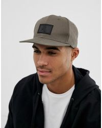 ASOS - Snapback Cap In Khaki With Rubber Badge Detail - Lyst