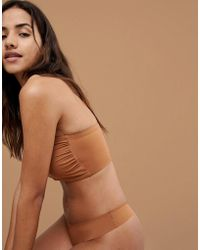 fec93db1d5 Nubian Skin - Naked Collection Nude Bandeau Bra In Warm - Lyst