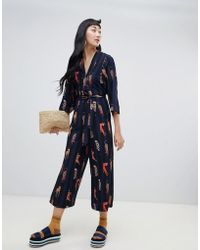 Monki - Stripe Belted Jumpsuit With Leopard Placement In Navy - Lyst
