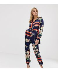e06000bf93b138 Missguided - Exklusiver langärmliger Jumpsuit mit Mustermix - Lyst