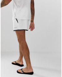 197f996d3d Calvin Klein Colourblock Side Logo Swim Shorts in White for Men - Lyst