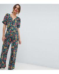 26551fcae70 Mango - Deep V Floral Printed Jumpsuit In Multi - Lyst