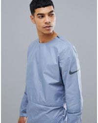Nike - Run Division Crinkle Effect Crew Jacket In Grey 928497-445 - Lyst