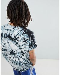 ASOS - Oversized Longline T-shirt With Roll Sleeve And Spiral Tie Dye Wash With Back Cross Eyelet Detail - Lyst